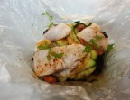 Photo Papillote de poisson, courgettes, riz vénéré et cacahuètes - LE DOMAINE DU SEUDRE