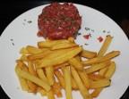 Photo *Tartare de bœuf préparé et coupé au couteau - Le Passy