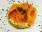 Photo Revuelto de papas confitadas con salmón - A Banda Restaurante