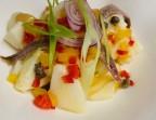 Photo Notre salade de pommes de terre relevée aux anchois et câpres - Bistrot Margaux